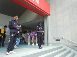 New signings Araujo (left) and Okha (right) hand out leaflets around town to promote MYFC's next match